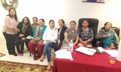 Myagdi Samaj's Treasurer Asha Pun Standing far left  and secretary Sita Thapa Pun in white jacket along with the ladies
